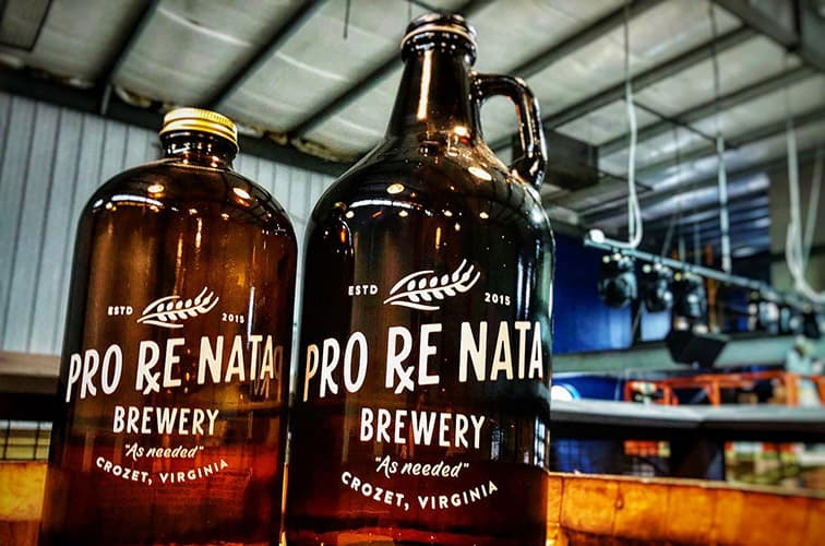 Two growlers of fresh beer made at Pro ReNata Brewery.